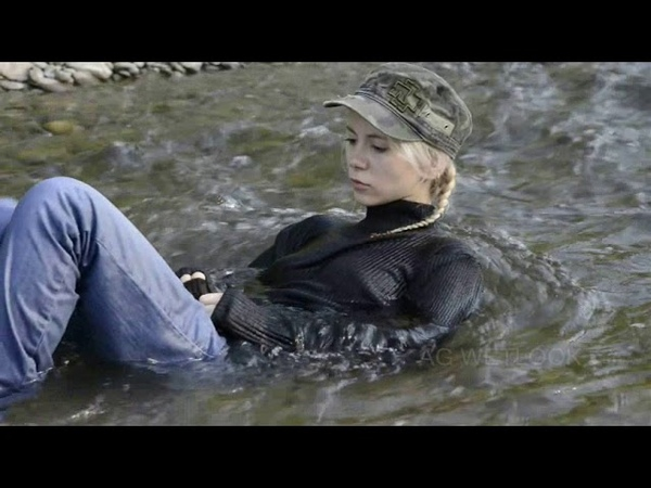 Wetlook Kelevra fully clothed in river with red converse preview
