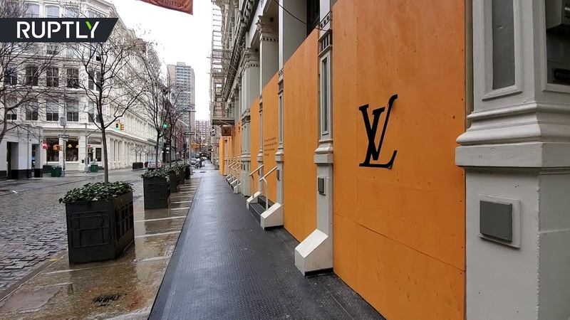 Pausing Luxury NY SoHo boutiques boarded up as COVID 19 cases surge