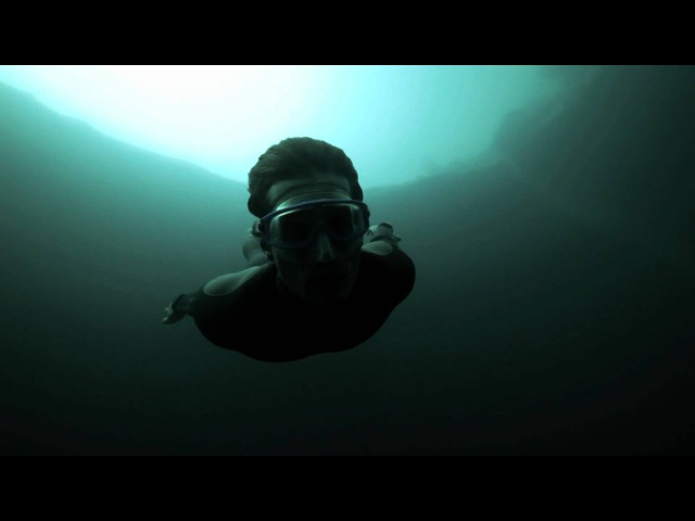 Guillaume Nery base jumping at Deans Blue Hole, filmed on breath hold by Julie Gautier