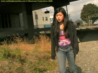 May C. chooses a great place to pee, and she has her tight jeans on in readiness - wp-0451