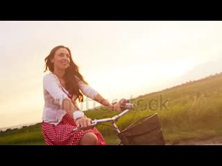 stock-footage-happy-young-woman-smiling-laughing-riding-bicycle-slow-motion.mp4