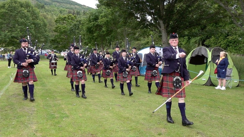 Vale Of Atholl Pipe Band march to start the 2019 Kenmore Highland Games in Perthshire, Scotland