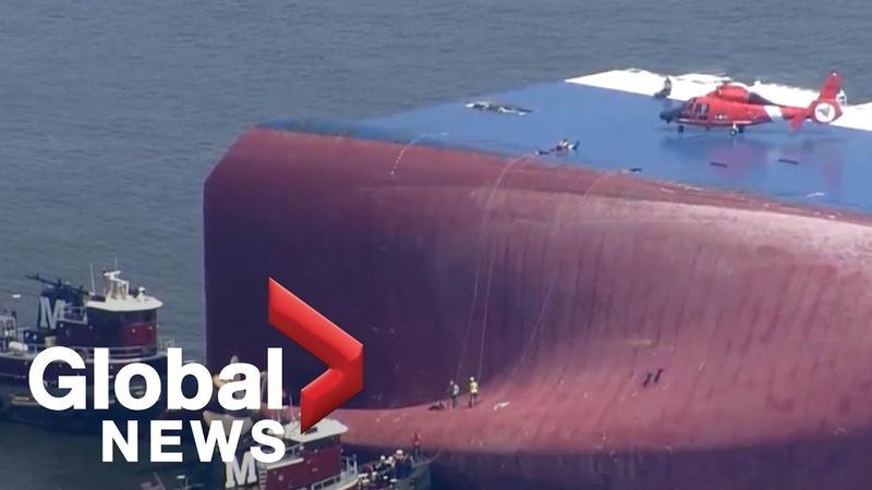 Coast Guard locate 4 crew trapped in capsized cargo ship