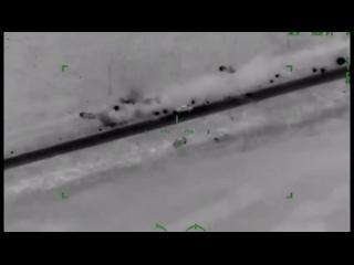 Ударные вертолёты Ми-35М ВВС Нигерии ведут огонь неуправляемыми авиационными ракетами по колонне террористов группировки ИГ .